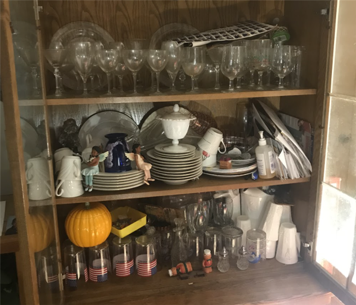 a hutch filled with glass belongings