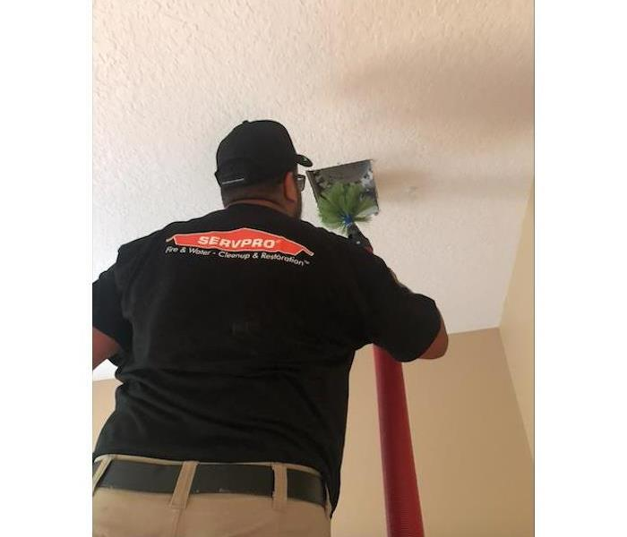 Worker cleaning air duct